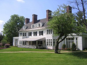 Vermont Vacation Deals offered at Four Chimneys Inn front exterior view in spring