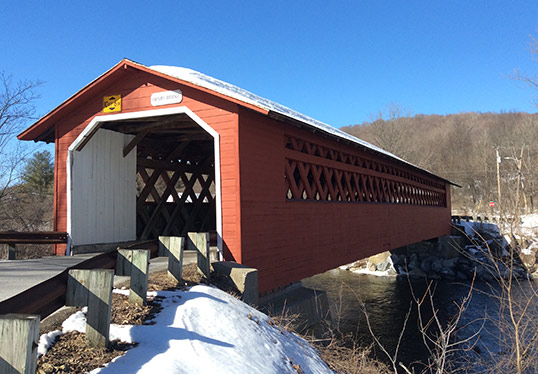 cored covered bridge in snow bennington vermont