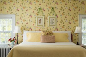 Room 5 bed bright and cheery yellow floral decor