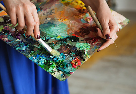 artist brushes with oil paint