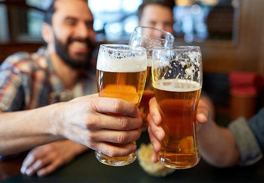 Men cheers with beer