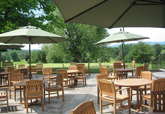 stone patio with tables and umbrellas at Mount Anthony Country Club Bennington Vermont