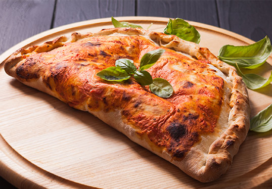 Calzone on serving tray