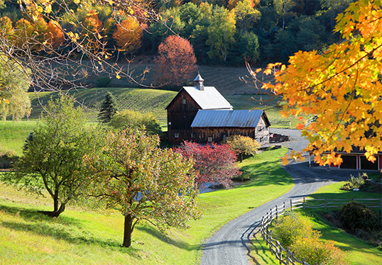 Vermont Fall Foliage with barn in distance