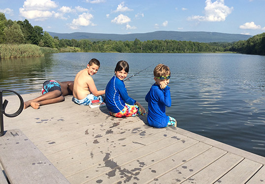 kids on doc at Lake Paran Vermont swimming hole