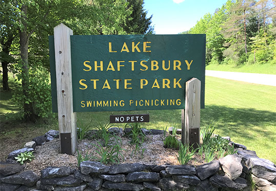 Sign for Lake Shaftsbury State Park with Swimming and Picnicking allowed No Pets
