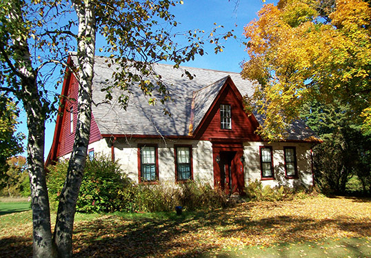 robert frost stone house exterior in fall foliage shaftsbury vermont