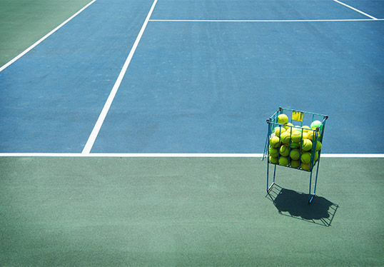 Balls in basket on Tennis Court