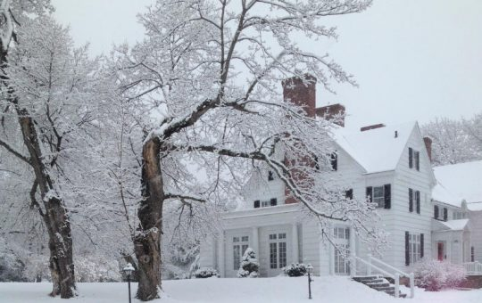 Winter Getaway at The Four Chimneys Inn snowcovered trees and exterior view of inn