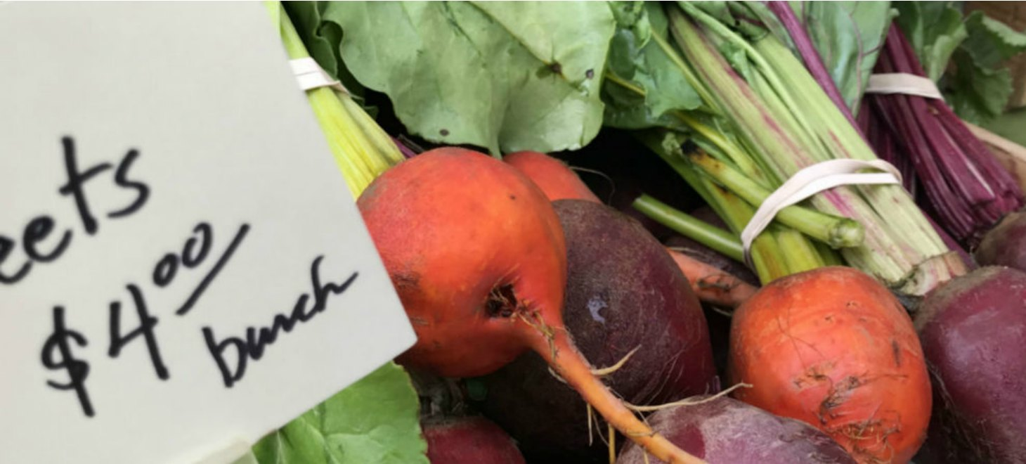 close up of fresh red and purple beets at VT farmers market