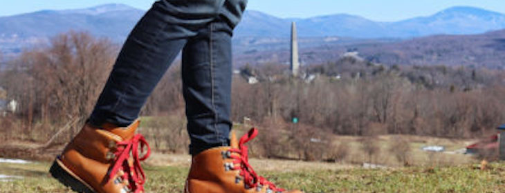 Hiker with Bennington Battle Monument in background Vista from Benningtnon Vermont Hiking Trails