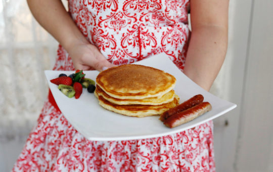 girl-in-red-apron-serving-pancakes-at-Vermont-bnb