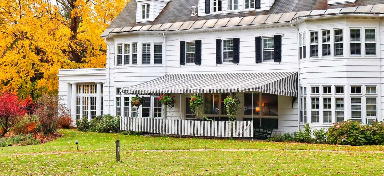 Four Chimneys vermont Inn exterior awning fall foliage