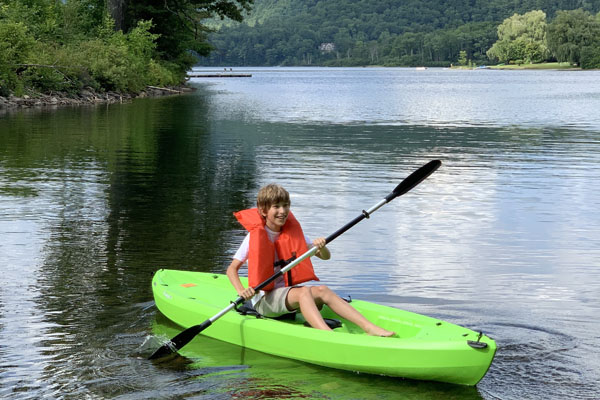 boy kayak vermont mountain lake