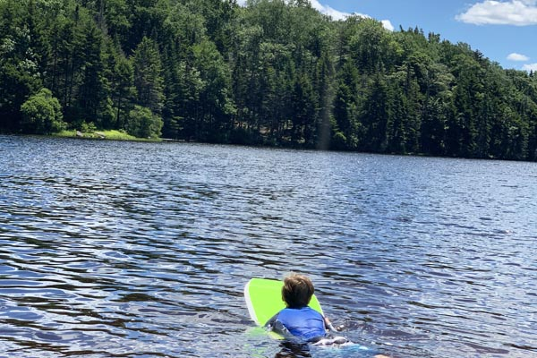 boy paddle board woodford vermont state park