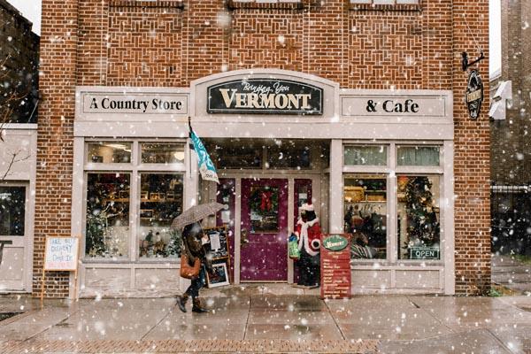 woman walking in snow umbrella bennington vermont country store